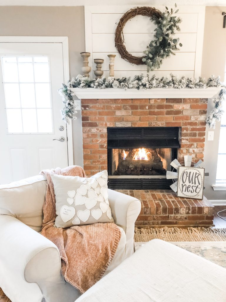 Cozy living room with fireplace and flocked swag