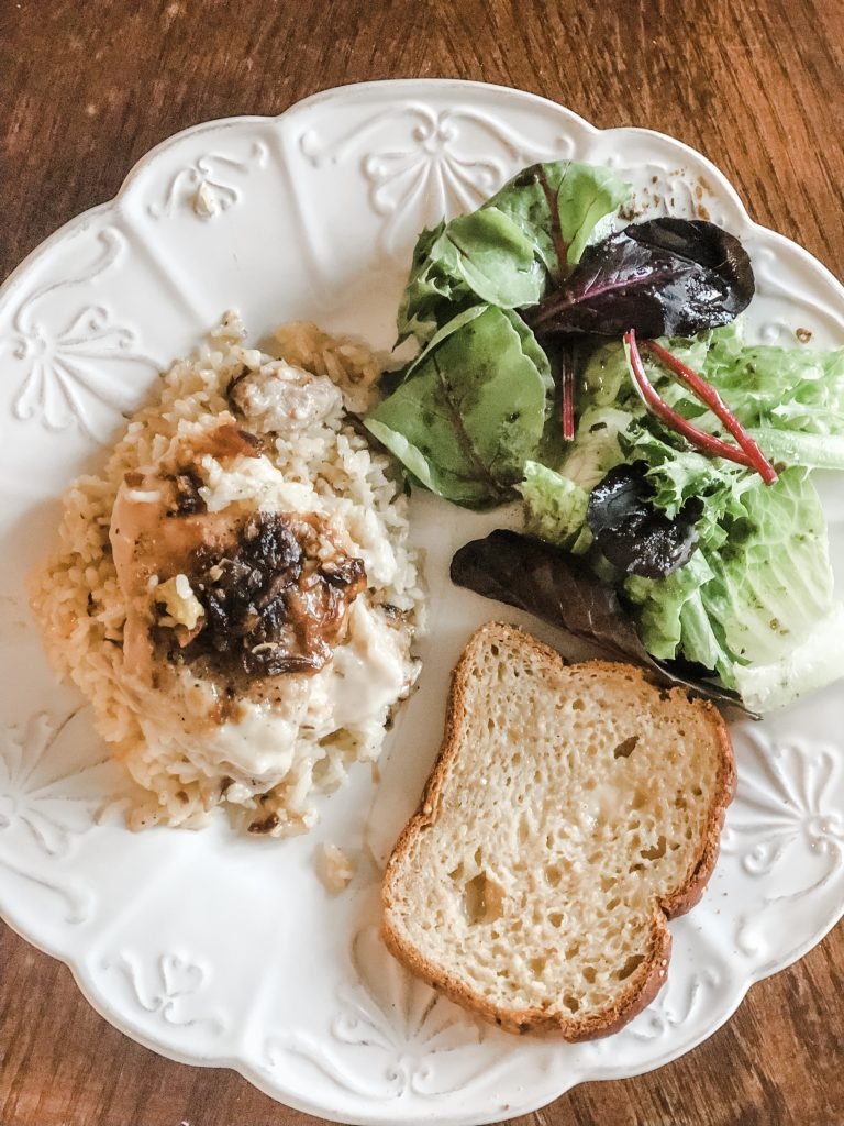 Comfort food chicken and rice with mixed green salad and toasted bread
