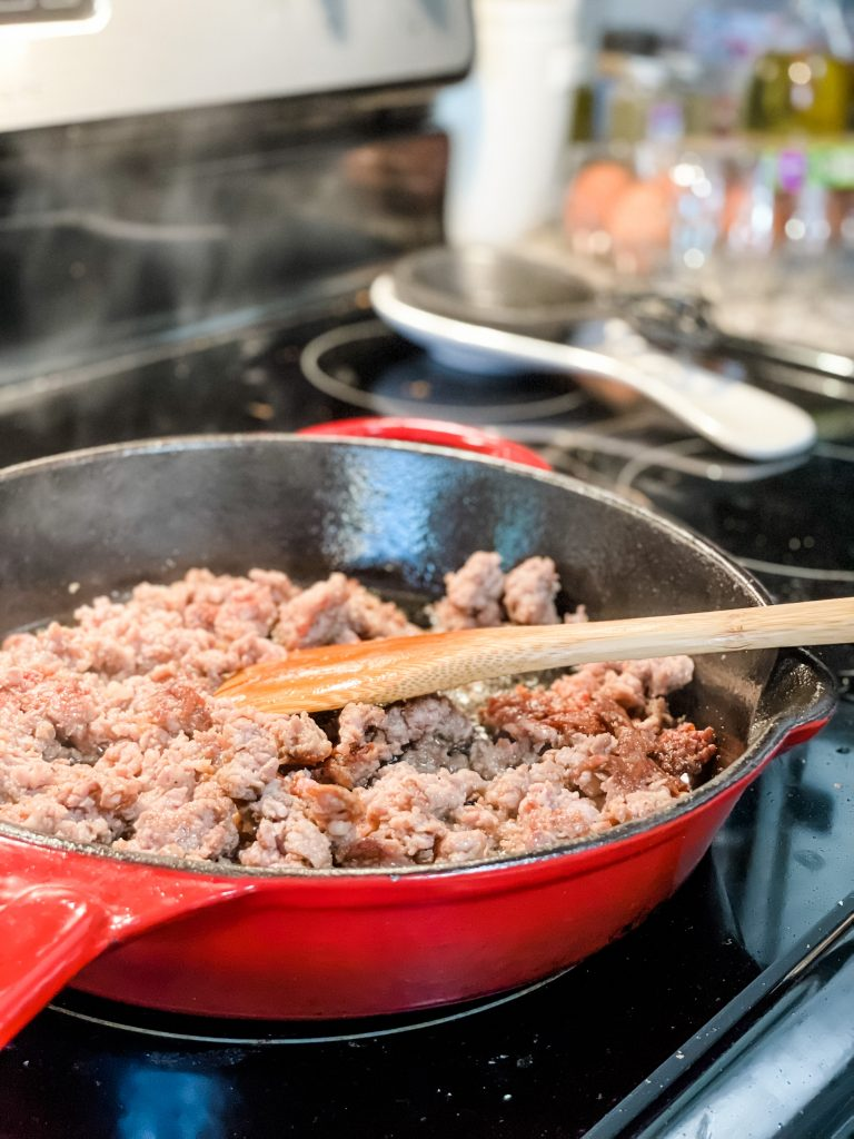 Breakfast sausage in a cast iron skillet cooking