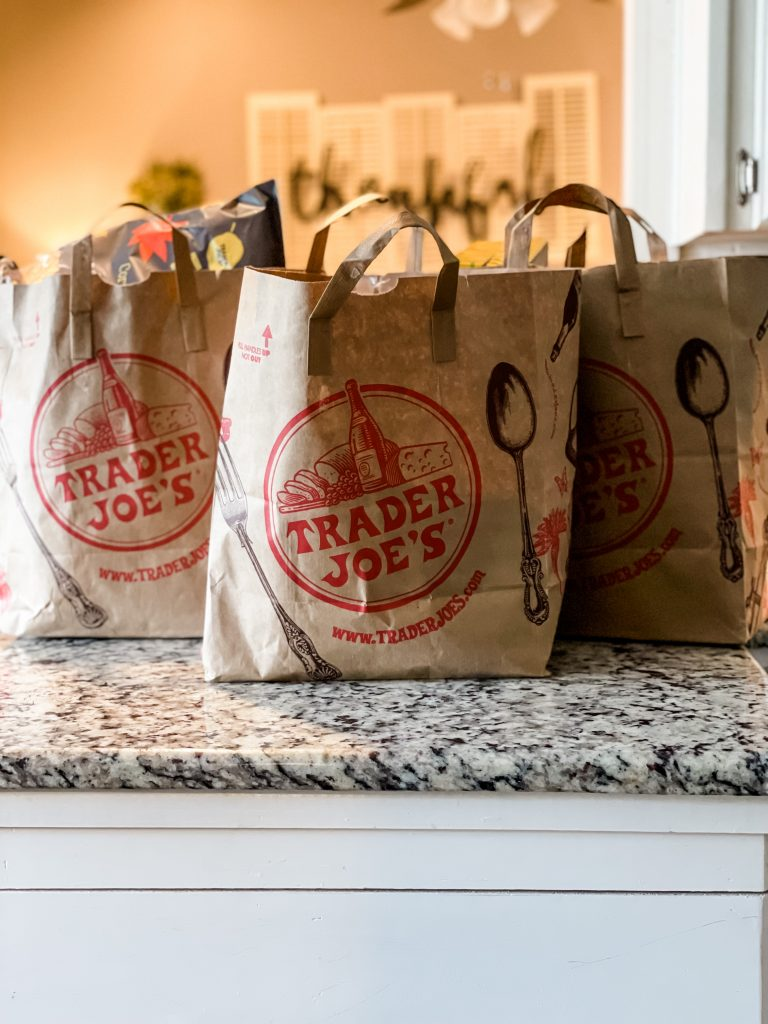 three trader joes bags on counter