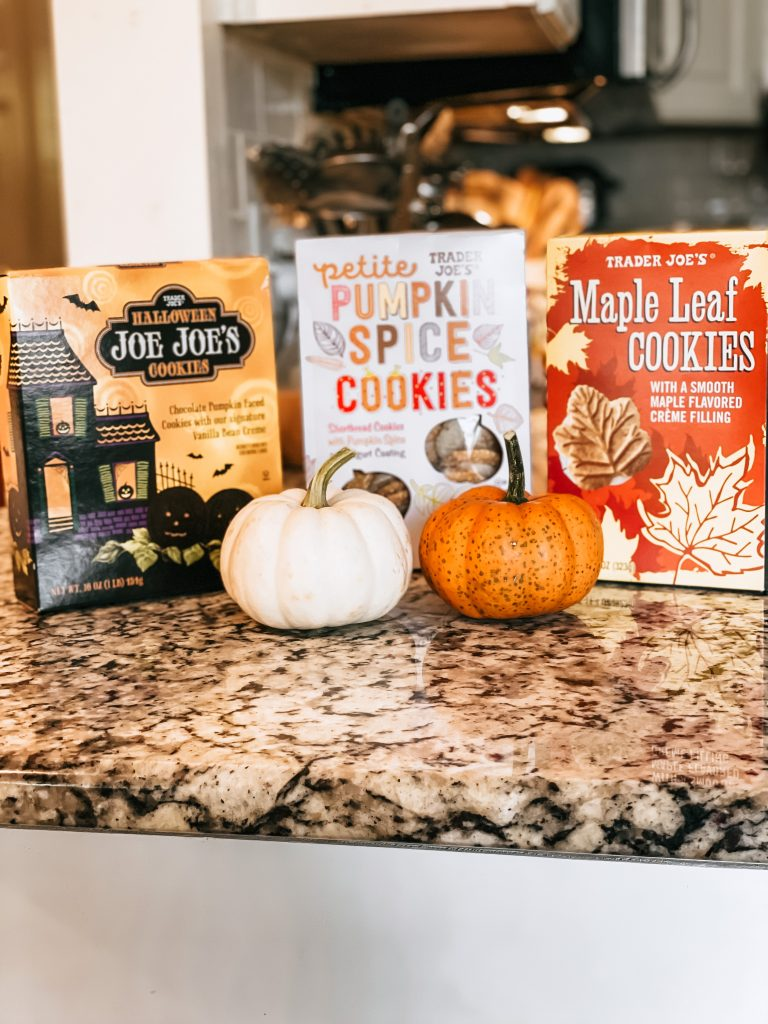 three boxes of fall trader joes cookies with pumpkins
